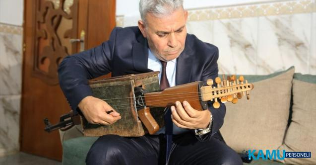 """Iraklı müzik öğretmeni kalaşnikoftan telli çalgı yaptı! """"Şiddetin değil müziğin sesi duyulsun diye"""""""
