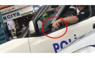 Resmi Araçta Telefonla Konuşup Sigara İçen Polis Memuruna Soruşturma Başlatıldı!