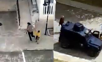 Nusaybin'de bir polis sokağa çıkan çocukları korkutmak için havaya ateş açıp kovaladı!